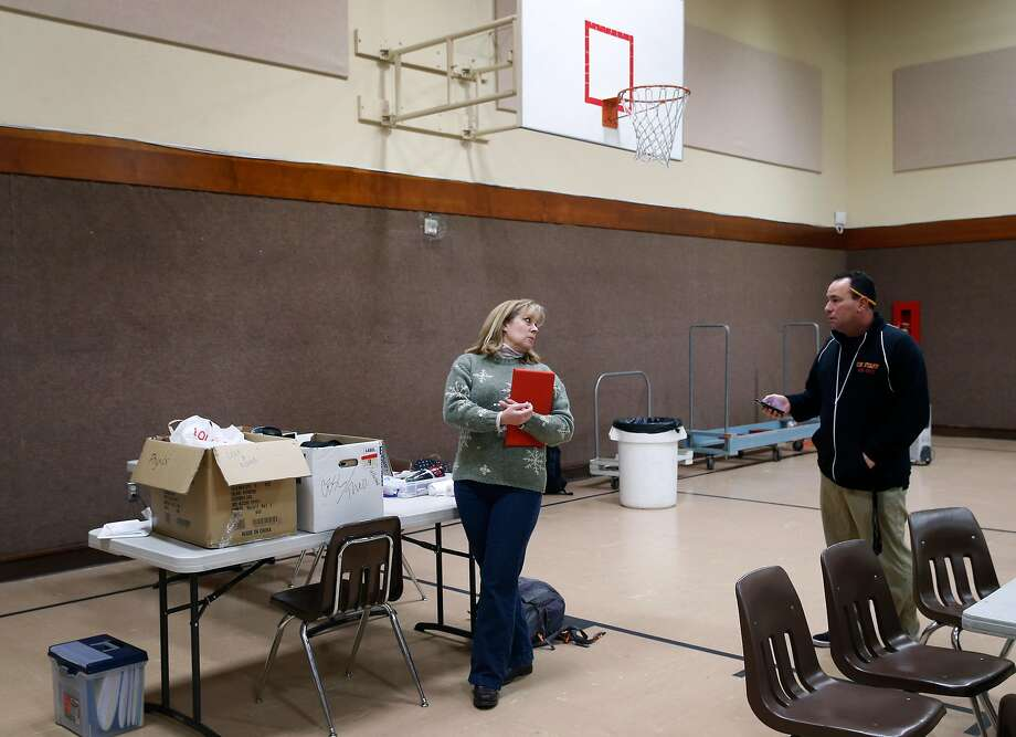 Math teachers Bernadette Calhoun and Tony Greco prepare for classes at St. Elizabeth Seton Catholic Church in Rohnert Park. Photo: Paul Chinn, The Chronicle