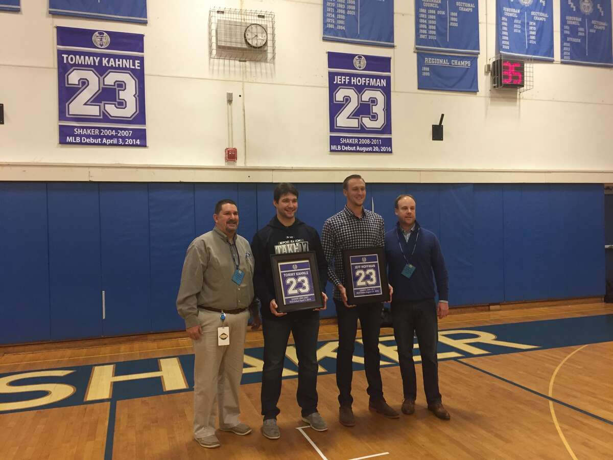 Shaker High School alums Tommy Kahnle, middle left, who pitches for the New York Yankees, and Jeff Hoffman, middle right, a pitcher for the Colorado Rockies, posed with former Shaker baseball coaches Ed Dopp, far left, and Stephen Frank, right, after their number 23 was retired by the Shaker baseball program on Dec. 20, 2017. (Leif Skodnick/Times Union)