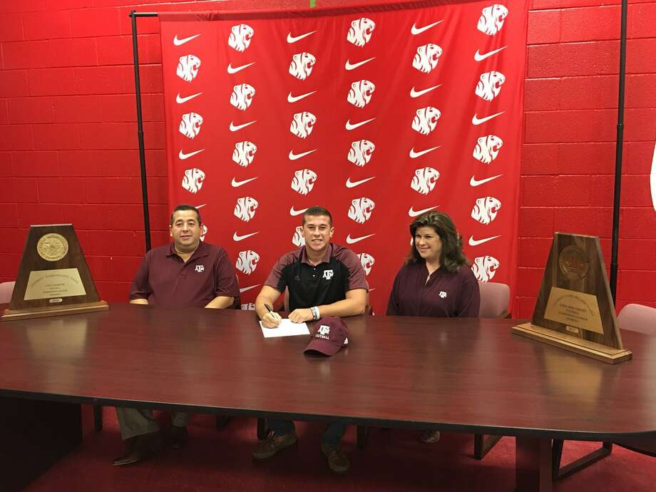 Katy kicker and punter Seth Small signs a National Letter of Intent to attend and play football at Texas A&M, Dec. 20 during the early signing period at Katy High School.