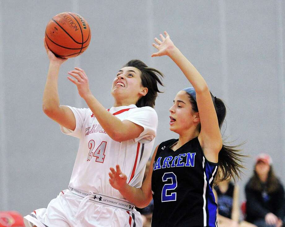 Greenwich's Tess Lamhaouar beats Darien defender Kelly Richter to score on a break-away layup during Thursday's FCIAC contest in Greenwich. Photo: Bob Luckey Jr. / Hearst Connecticut Media / Greenwich Time