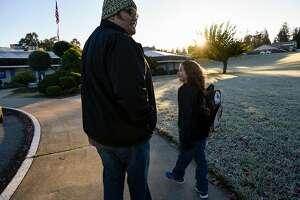 Ariel Juarez drops off his son Orion Juarez, 6, at his elementary school in San Jose, Calif., on Thursday December 21, 2017.