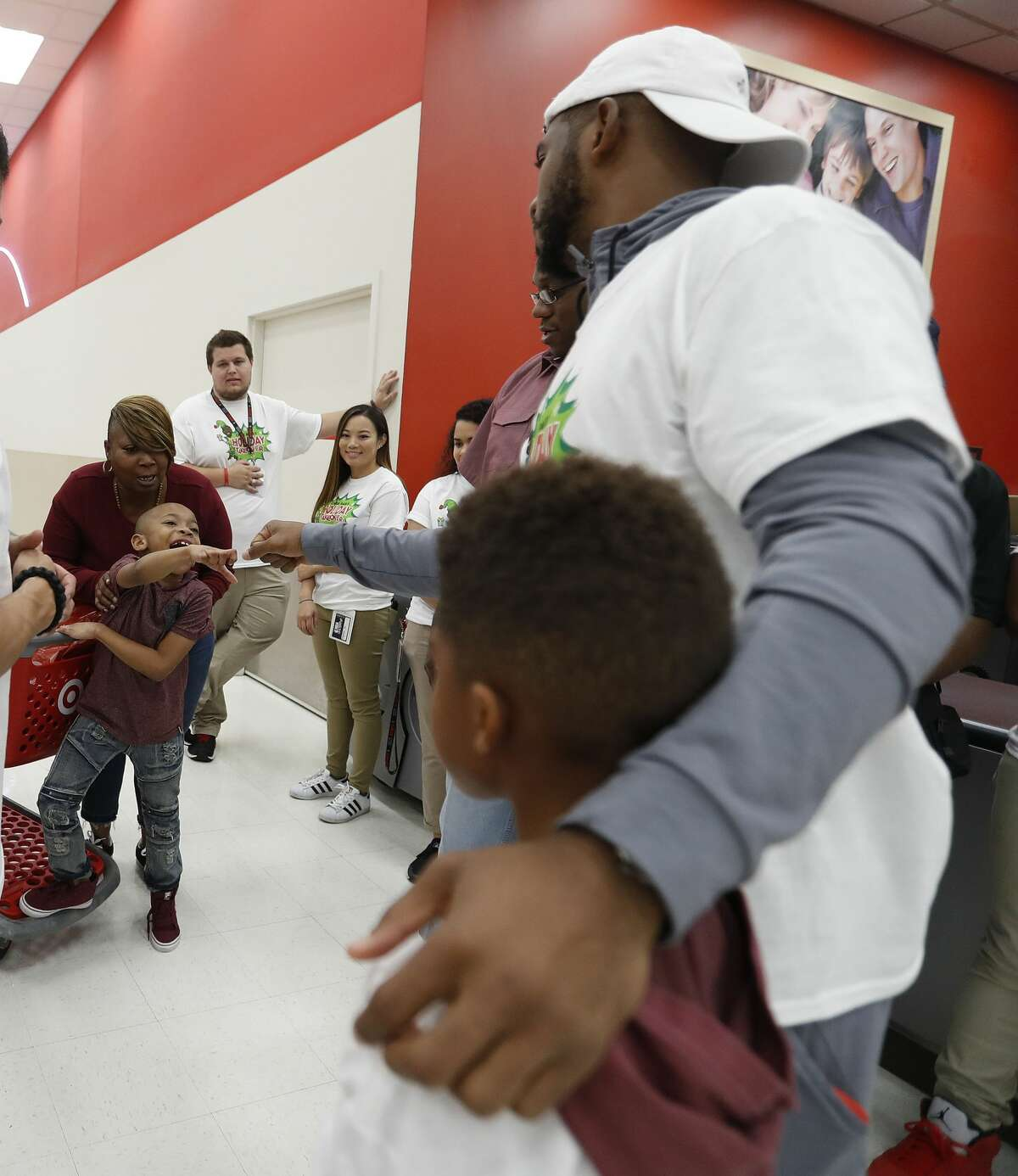 Houston Rocket Chris Paul high-fives Jacody Pollard, 6, as he and The Chris Paul Family Foundation took 100 children from the Houston community on a holiday shopping spree at Target, Thursday, Dec. 21, 2017, in Houston. ( Karen Warren / Houston Chronicle )