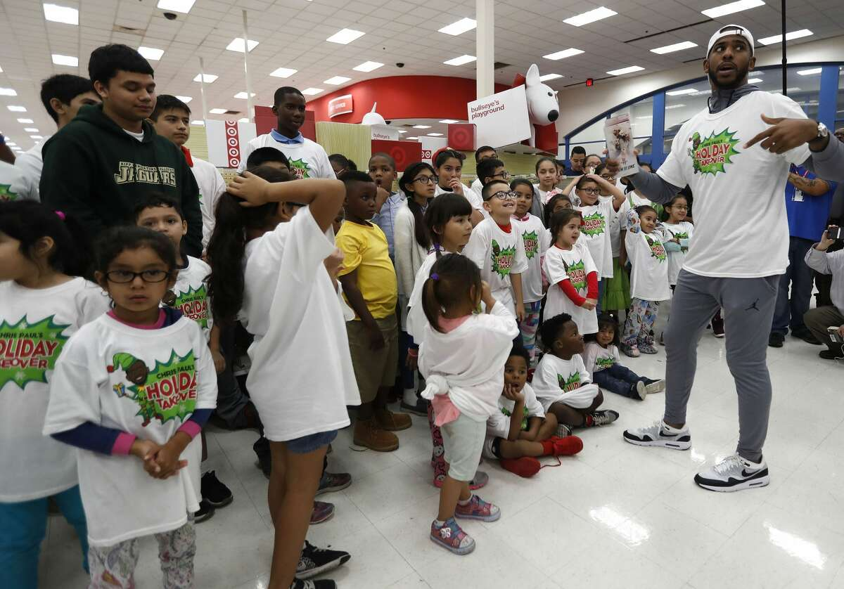 Houston Rocket Chris Paul speaks to children from KIPP as he and The Chris Paul Family Foundation prepared to take their group, part of 100 children from the Houston community on a holiday shopping spree at Target, Thursday, Dec. 21, 2017, in Houston. ( Karen Warren / Houston Chronicle )