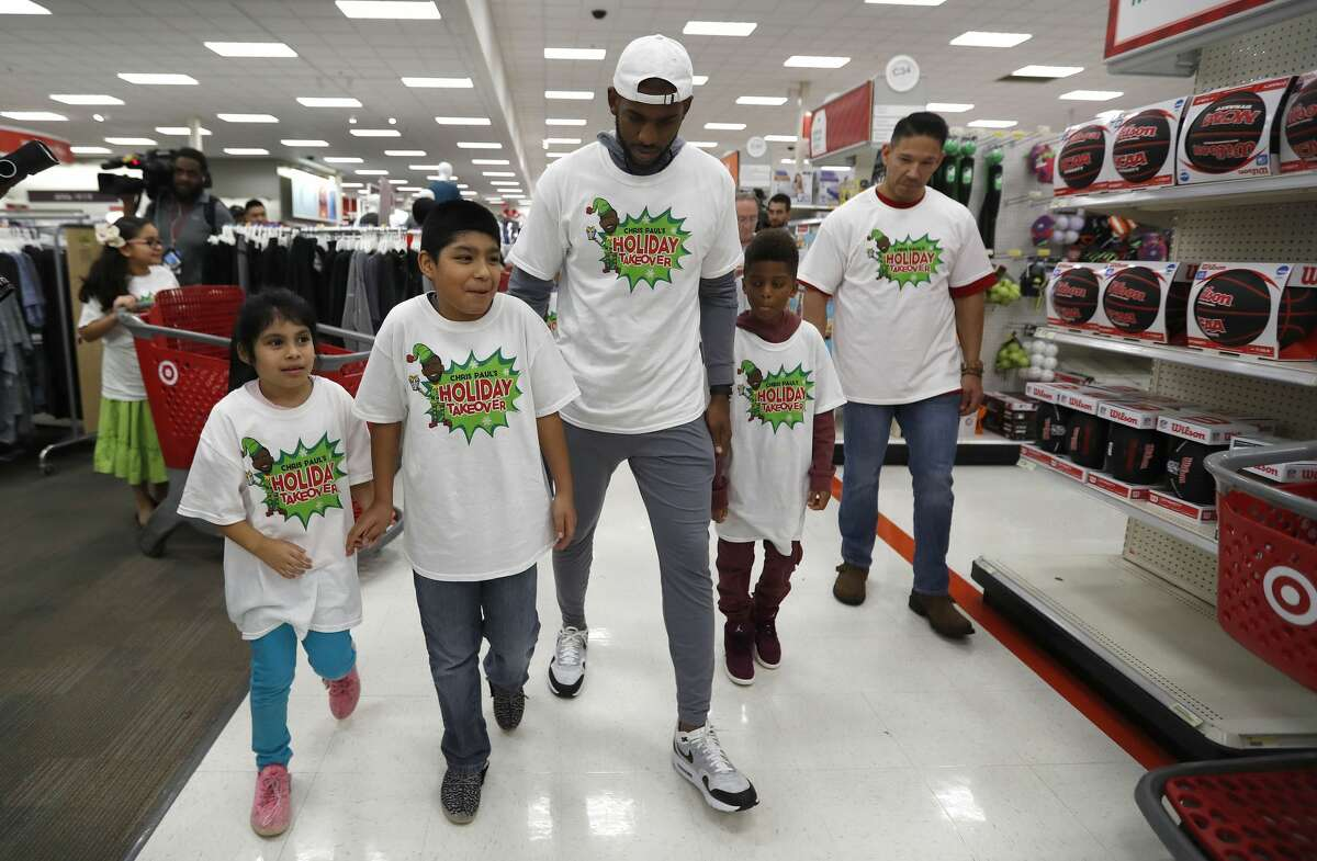 Houston Rocket Chris Paul walks with children from KIPP as he and The Chris Paul Family Foundation prepared to take their group, part of 100 children from the Houston community on a holiday shopping spree at Target, Thursday, Dec. 21, 2017, in Houston. ( Karen Warren / Houston Chronicle )