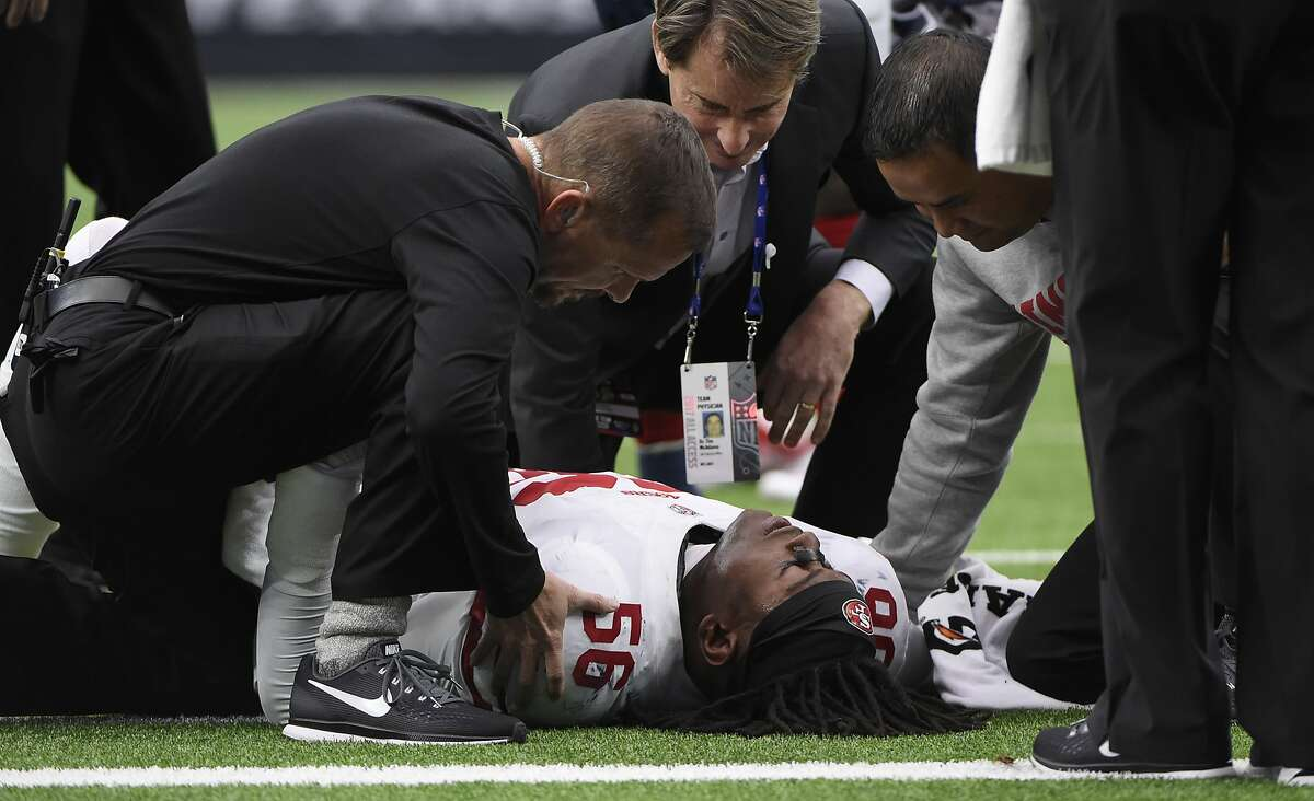 San Francisco 49ers outside linebacker Reuben Foster (56) is helps on the field after an injury during the first half of an NFL football game against the Houston Texans, Sunday, Dec. 10, 2017, in Houston. (AP Photo/Eric Christian Smith)