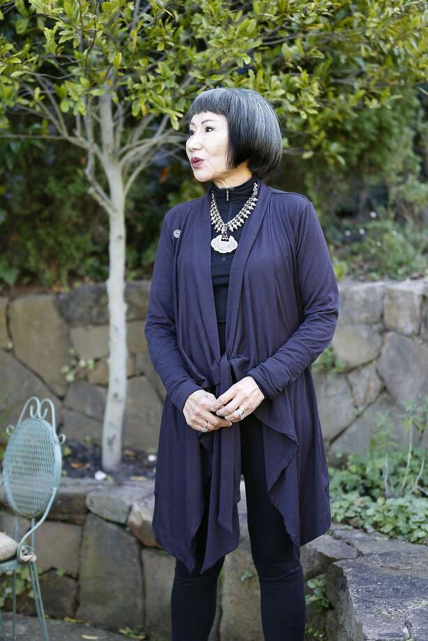 Amy Tan in her garden making bird calls on Monday, September 25, 2017, in Sausilito, Calif. Photo: Liz Hafalia, The Chronicle