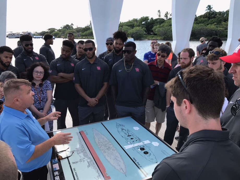 "The UH football team and staff members spent Thursday afternoon touring Pearl Harbor. One player said it was a ""once-in-a-lifetime experience."""