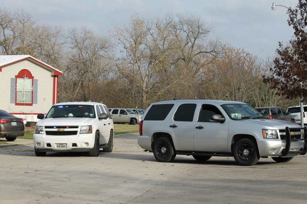 A 7-year-old boy was fatally shot when Bexar County sheriff's deputies opened fire on a woman at a Schertz mobile home park after a lengthy manhunt Thursday. The woman - a wanted felon and a suspect in a car theft - also was killed by the gunfire.