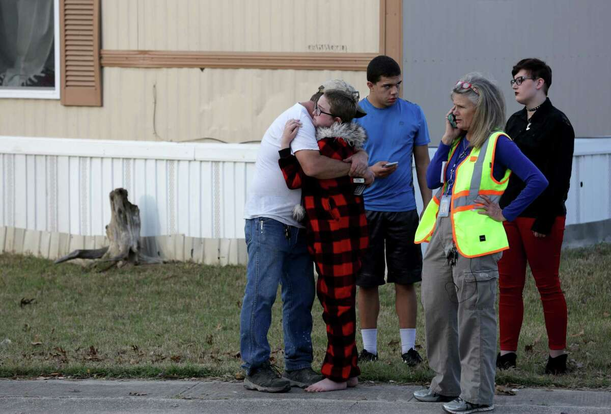 Ron Lawrence (left) comforts his daughter Kallie Lawrence, 11, who knew the 7-year-old boy that was killed Thursday in Schertz.