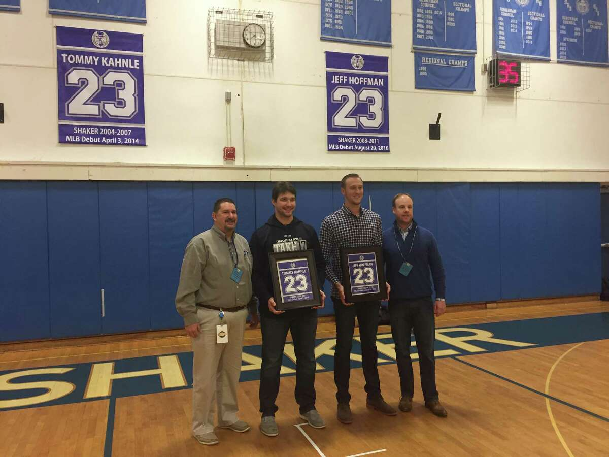 Shaker High School alums Tommy Kahnle, middle left, who pitches for the New York Yankees, and Jeff Hoffman, middle right, a pitcher for the Colorado Rockies, pose with former Shaker baseball coaches Ed Dopp, far left, and Stephen Frank, right, after their No. 23 was retired by the Shaker baseball program on Dec. 20, 2017. (Leif Skodnick/Times Union)