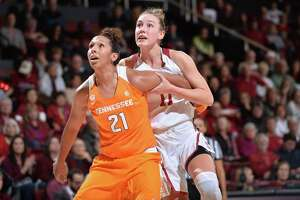 Mercedes Russell of Tennessee boxes out Stanford Forward Alana Smith during an NCAA women's basketball game between Stanford and Tennessee at Maples Pavilion in Stanford, Calif. on Thursday December 21, 2017.