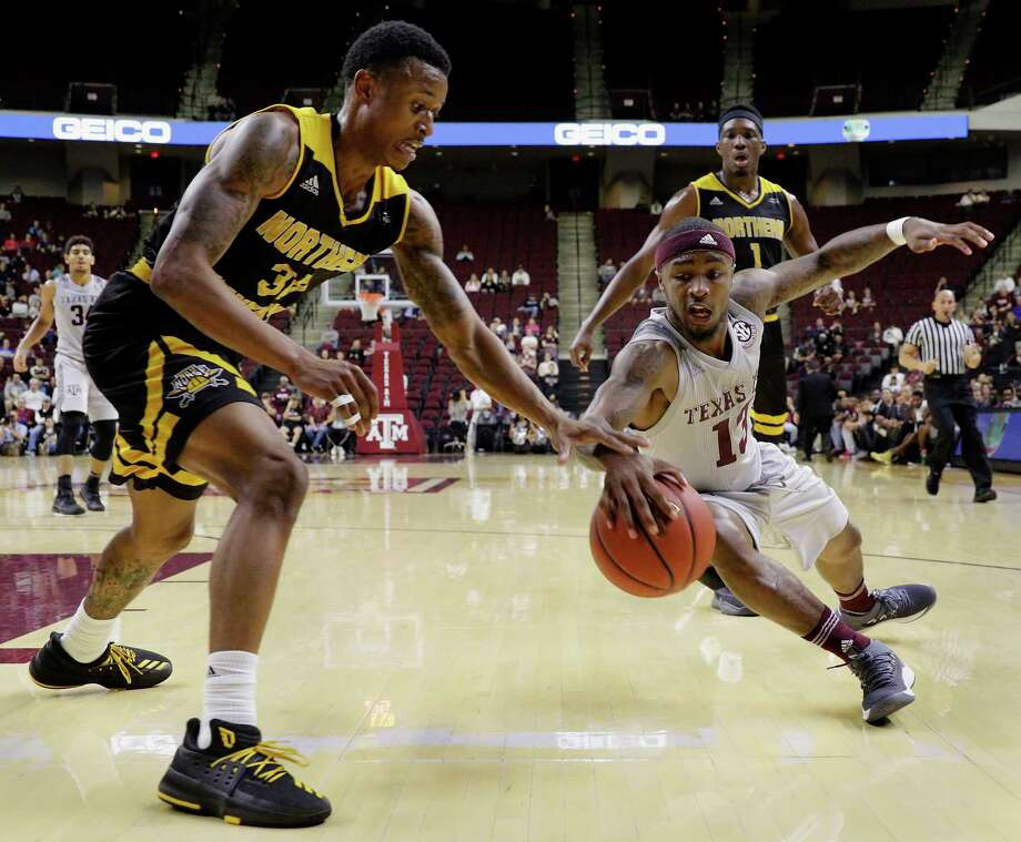 Texas A&M guard Duane Wilson (13) dives for a loose ball as Northern Kentucky guard Lavone Holland II (30) reaches in during the first half of an NCAA college basketball game Tuesday, Dec. 19, 2017, in College Station, Texas. (AP Photo/Michael Wyke) Photo: Michael Wyke, Associated Press / © Associated Press 2017