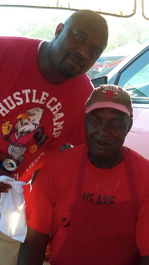 Terrance Roberts, standing, was shot dead during a Father's Day barbecue in Albany's South End on Sunday, June 18, 2017.He is pictured here with his father, Andrew Evans.  (Provided by Toya Mcgill)