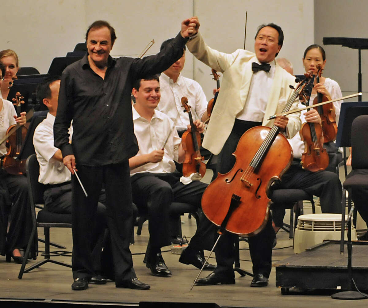 Conductor Charles Dutoit welcomes Yo-Yo Ma to play his cello with the Philadelphia Orchestra at the Saratoga Performing Arts Center in Saratoga Springs, NY on August 4, 2010. (Lori Van Buren / Times Union)