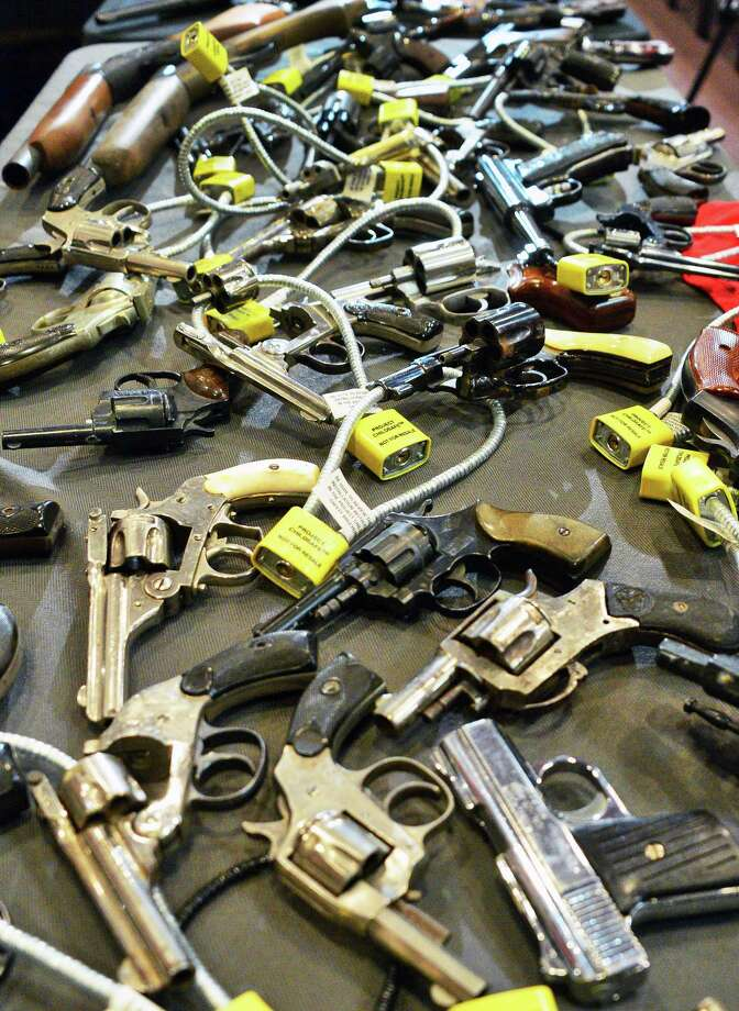 Guns collected during the Gun Buy Back Program on display during a news conference Thursday Dec. 21, 2017 in Albany, NY.  (John Carl D'Annibale / Times Union) Photo: John Carl D'Annibale / 20042468A