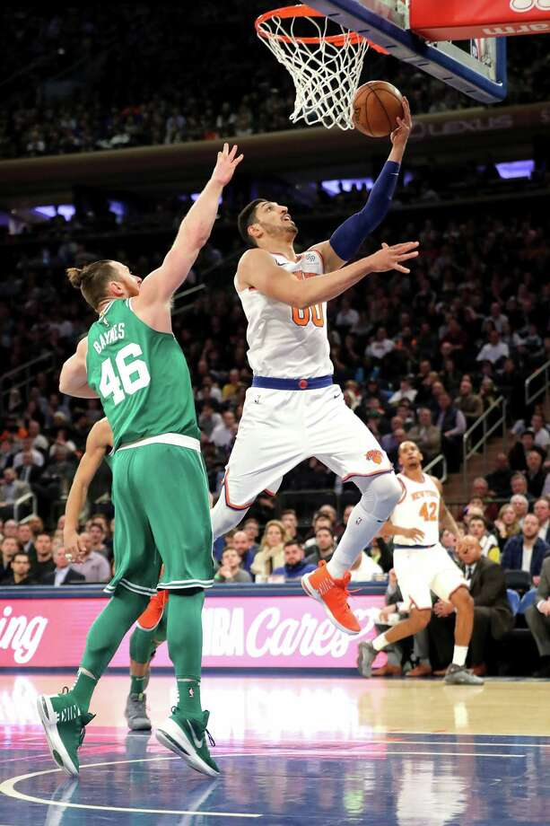 NEW YORK, NY - DECEMBER 21: Enes Kanter #00 of the New York Knicks takes a shot against Aron Baynes #46 of the Boston Celtics in the first quarter during their game at Madison Square Garden on December 21, 2017 in New York City. NOTE TO USER: User expressly acknowledges and agrees that, by downloading and or using this photograph, User is consenting to the terms and conditions of the Getty Images License Agreement.  (Photo by Abbie Parr/Getty Images) Photo: Abbie Parr / 2017 Getty Images