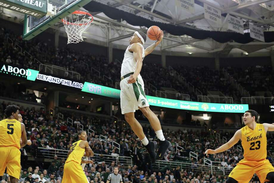 EAST LANSING, MI - DECEMBER 21: Miles Bridges #22 of the Michigan State Spartans dunks the ball during the game against the Long Beach State 49ers at Breslin Center on December 21, 2017 in East Lansing, Michigan. (Photo by Rey Del Rio/Getty Images) Photo: Rey Del Rio / 2017 Getty Images