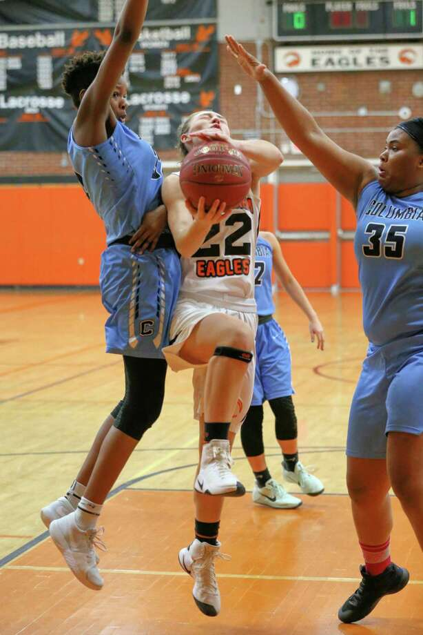 Maggie Kirby #22 of The Bethlehem Eagles drives to the basket while defends by two The Columbia Blue Devils on 12/21/17 in Delmar NY. Photo: Robert Dungan (Special to the Times Union) ORG XMIT: MER2017082023255053 Photo: Robert Dungan / Robert Dungan 2017