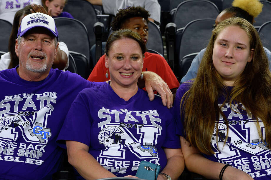 Newton fans Tommy Daniel, Ann McFatter and M'kenzie Mechling at the Class 3A Division II state final at AT&T Stadium in Arlington on Thursday evening.  Photo taken Thursday 12/21/17 Ryan Pelham/The Enterprise Photo: Ryan Pelham / ©2017 The Beaumont Enterprise/Ryan Pelham
