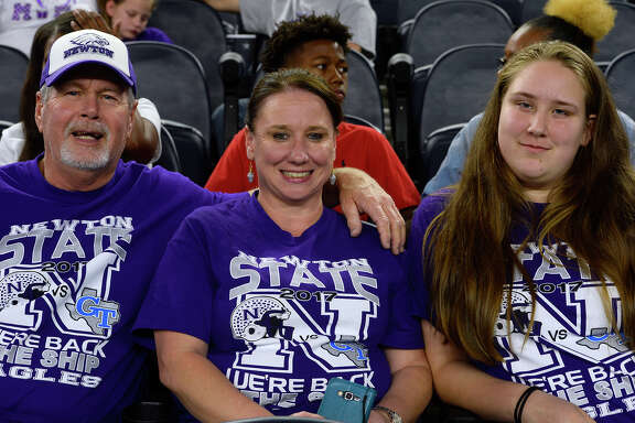 Newton fans Tommy Daniel, Ann McFatter and M'kenzie Mechling at the Class 3A Division II state final at AT&T Stadium in Arlington on Thursday evening.  Photo taken Thursday 12/21/17 Ryan Pelham/The Enterprise