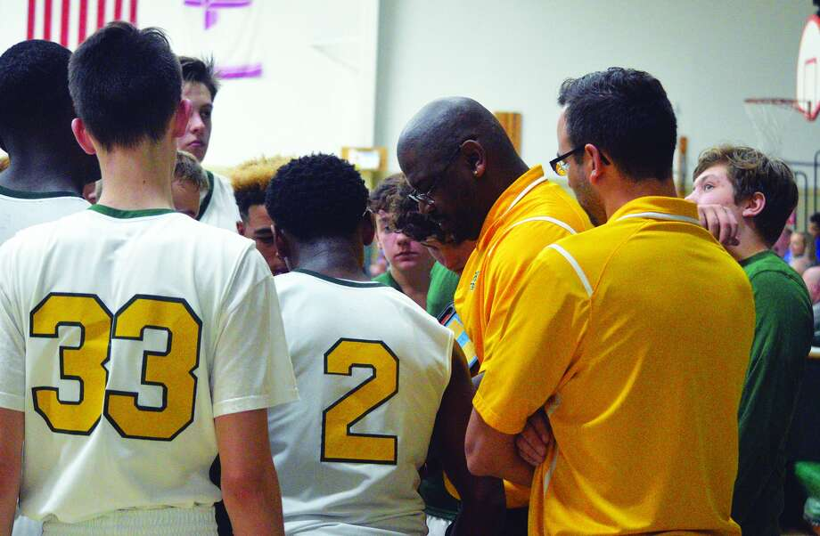 Metro-East Lutheran coach Anthony Smith talks to his team during a timeout against Greenville in a home game this season.