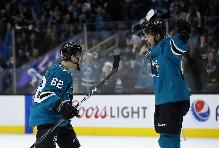 The Sharks' Kevin Labanc (62) and Tomas Hertl celebrate after Labanc scored the winning goal in overtime. Photo: Ezra Shaw, Getty Images