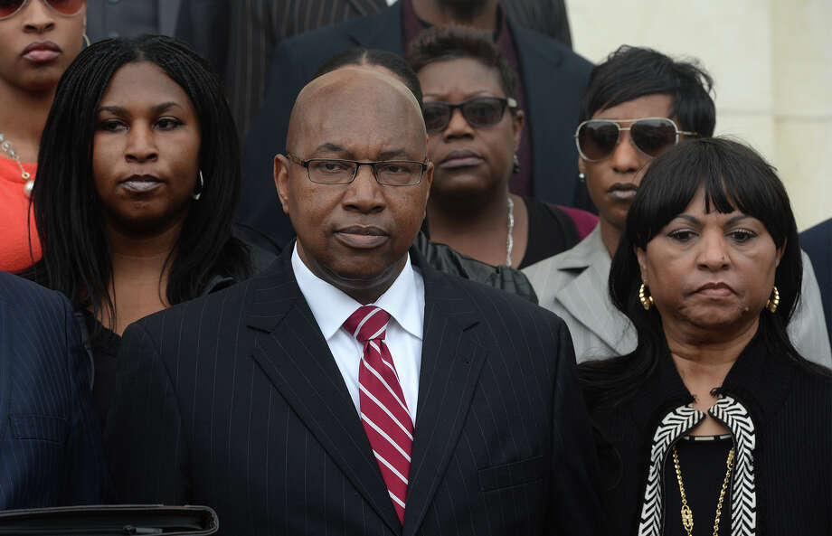 Walter Diggles, center, the Executive Director of the Deep East Texas Council of Governments, his wife Rosie Diggles, right and daughter Anita Diggles, left, are named in a federal indictment stemming from the FBI's 2014 raid of the DETCOG offices. Photo taken during a press conference at the Federal Courthouse on Monday.