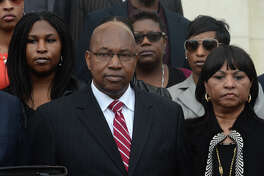 Walter Diggles, center, the Executive Director of the Deep East Texas Council of Governments, his wife Rosie Diggles, right and daughter Anita Diggles, left, are named in a federal indictment stemming from the FBI's 2014 raid of the DETCOG offices. Photo taken during a press conference at the Federal Courthouse on Monday. Photo taken Monday, December 21, 2015 Guiseppe Barranco/The Enterprise
