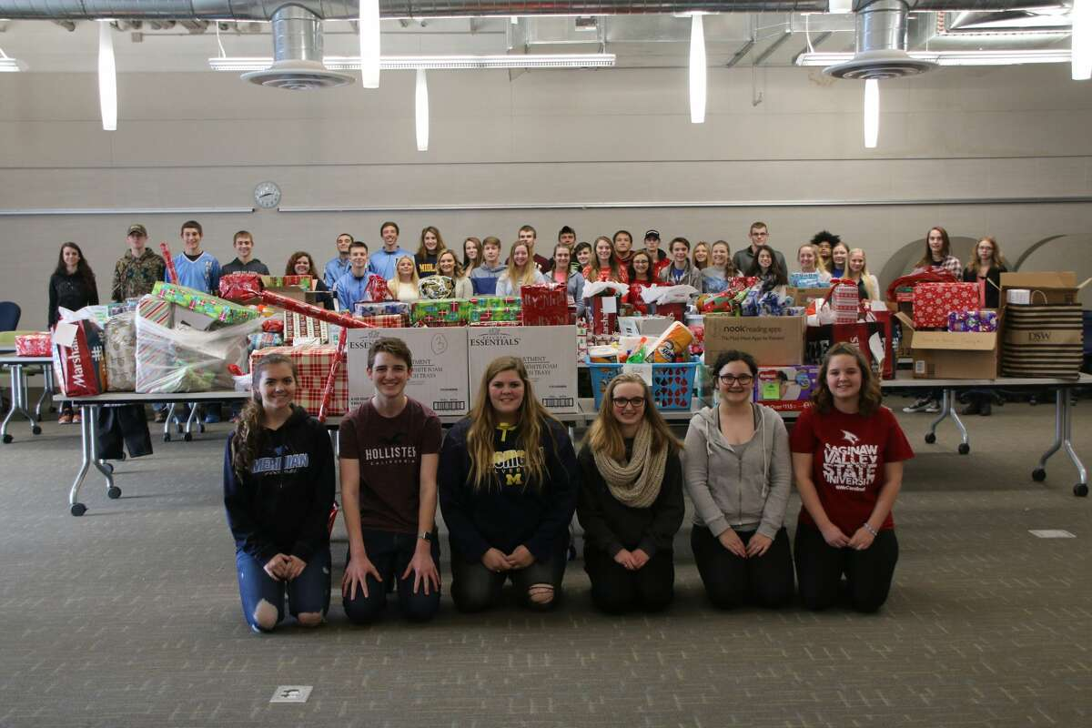 Meridian Early College High School students with some of the many presents that are being gifted to 10 families the school adopted for Christmas this year.