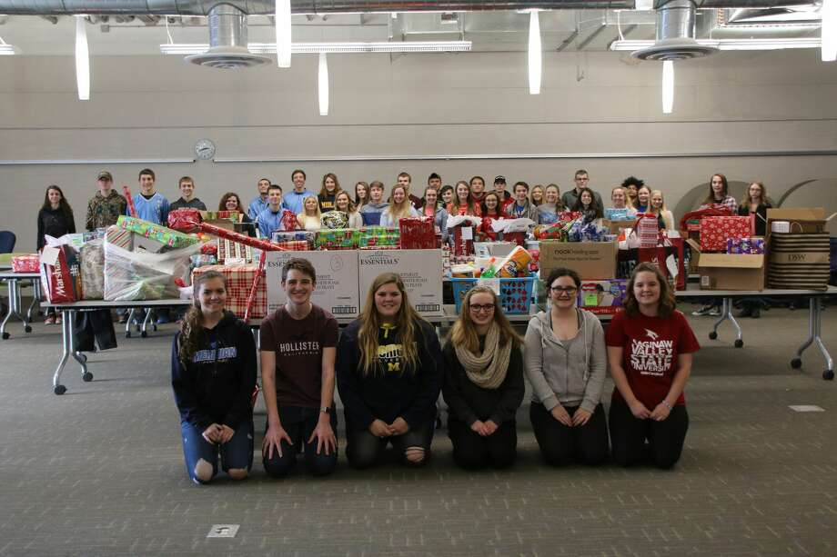 Meridian Early College High School students with some of the many presents that are being gifted to 10 families the school adopted for Christmas this year. Photo: Photo Provided