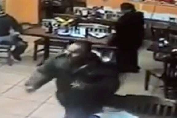 Surveillance video captured the suspect in the stabbing at Lola's Market.