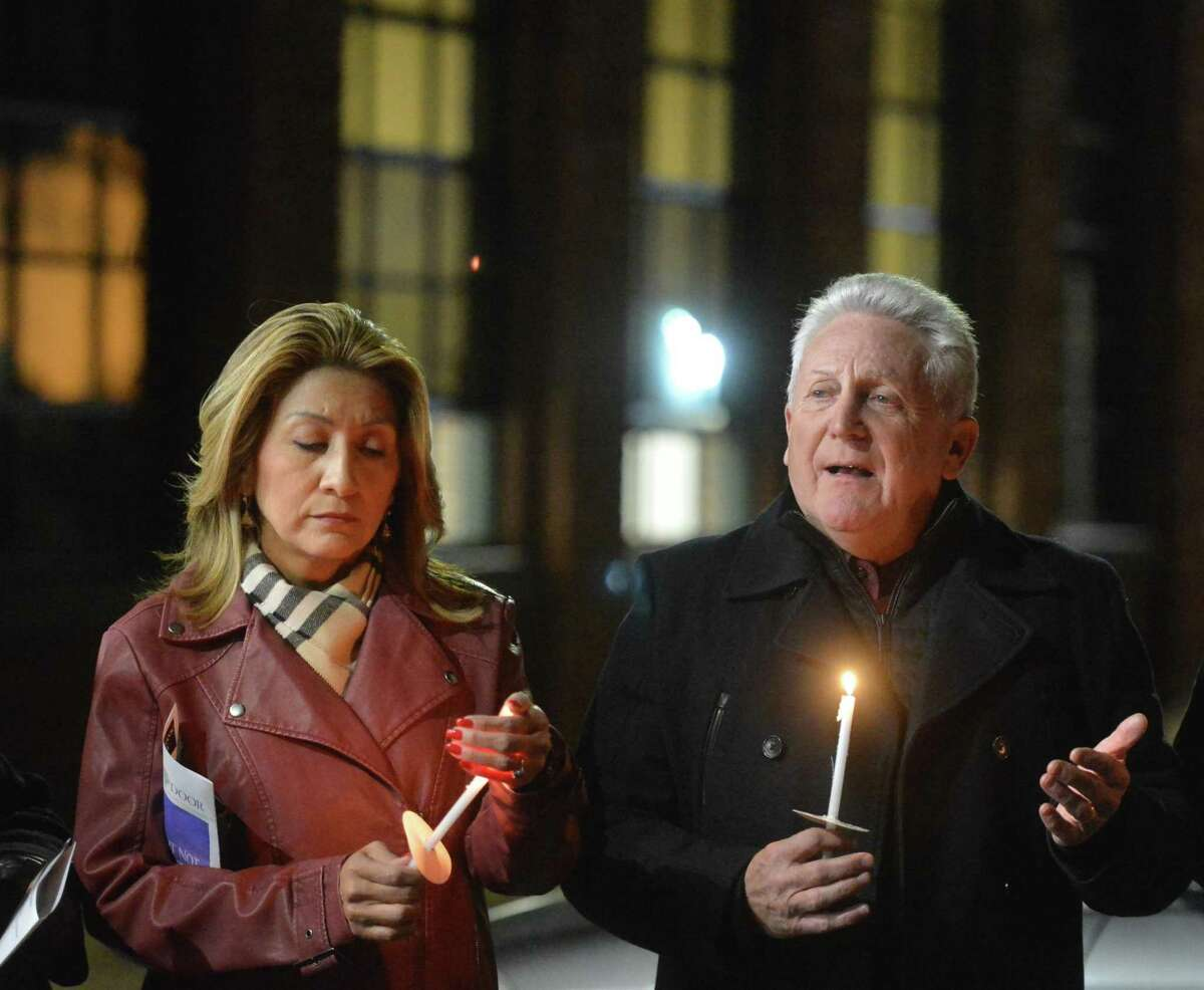 Norwalk Mayor Harry Rilling and wife Lucia talk to the group at The Smilow Life Center during Homeless Persons' Memorial Day Candleight Remembrance Service at the Open Door's center on Thursday December 21, 2017 in Norwalk Conn.