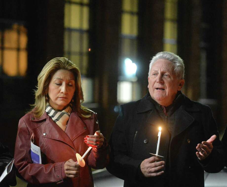Norwalk Mayor Harry Rilling and wife Lucia talk to the group at The Smilow Life Center during Homeless Persons' Memorial Day Candleight Remembrance Service at the Open Door's center on Thursday December 21, 2017 in Norwalk Conn. Photo: Alex Von Kleydorff / Hearst Connecticut Media / Norwalk Hour