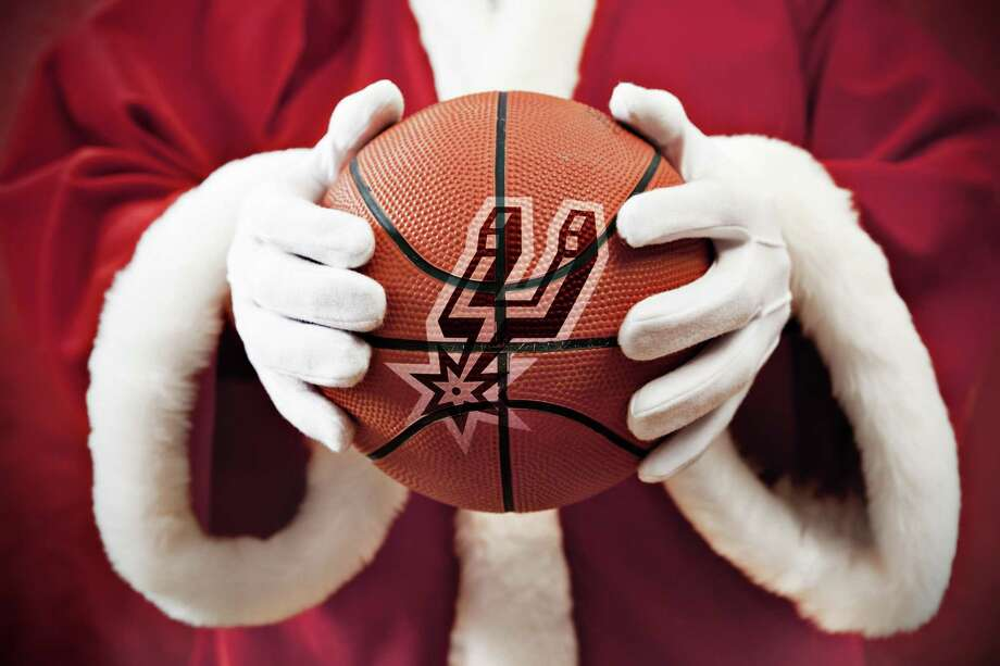 Might Jolly Old Saint Nick be a Spurs fan? Photo: Photo Illustration By Adrian Alvarez With A Photo FromGetty Images / Alija