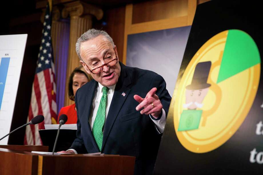 Senate Minority Leader Chuck Schumer (D-N.Y.) and House Minority Leader Nancy Pelosi (D-Calif.) at a news conference on the Republican tax bill in Washington, Dec. 20, 2017. The House, forced to vote a second time on the $1.5 trillion tax bill, moved swiftly to pass the final version on Wednesday, clearing the way for President Trump to sign into law the most sweeping tax overhaul in decades. (Al Drago/The New York Times) Photo: AL DRAGO, STR / NYTNS