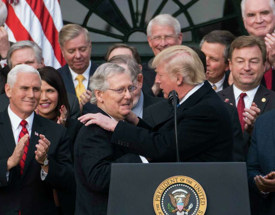 President Donald Trump with Senate Majority Leader Mitch McConnell (R-Ky.)  during an event marking the passage of the Republican tax bill at the White House in Washington, Dec. 20, 2017. The House, forced to vote a second time on the $1.5 trillion tax bill, moved swiftly to pass the final version on Wednesday, clearing the way for President Trump to sign into law the most sweeping tax overhaul in decades. (Doug Mills/The New York Times) Photo: DOUG MILLS, STF / NYTNS
