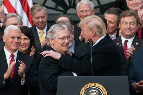 President Donald Trump with Senate Majority Leader Mitch McConnell (R-Ky.)  during an event marking the passage of the Republican tax bill at the White House in Washington, Dec. 20, 2017. The House, forced to vote a second time on the $1.5 trillion tax bill, moved swiftly to pass the final version on Wednesday, clearing the way for President Trump to sign into law the most sweeping tax overhaul in decades. (Doug Mills/The New York Times)