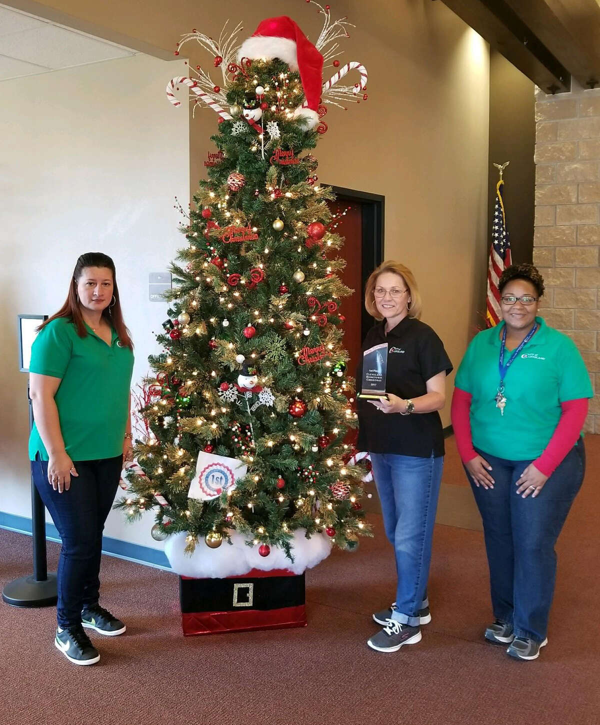 The judges picked Cleveland Civic Center to be the first-place winner in the Hometown Christmas Tree Contest. The trees adorned the civic center throughout the two-day Hometown Christmas event. Pictured are left to right are Marina Ybanez, Frieda Joyce and Ashleigh Broussard.