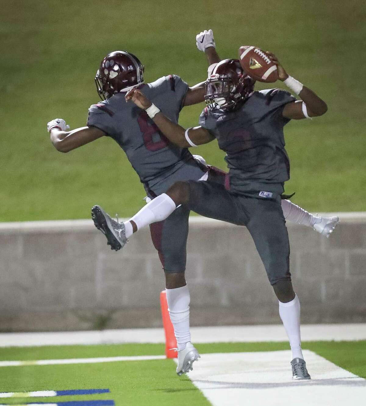 Heights' Jacoby Hopkins (8) celebrates with teammate Jalen Green (3) after scoring a touchdown against Bellaire at Delmar Stadium Friday, Oct. 6, 2017, in Houston. ( Steve Gonzales / Houston Chronicle )