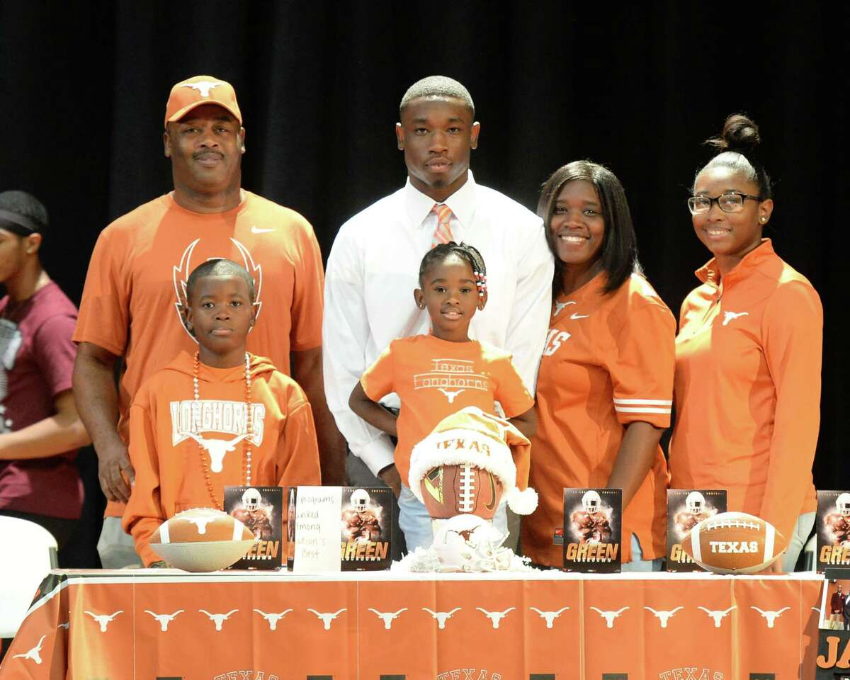 Jalen Green is surrounded by his family after he signed a commitment to play football for the University of Texas, at Heights High School in Houston, TX on Wednesday, December 20, 2017.
