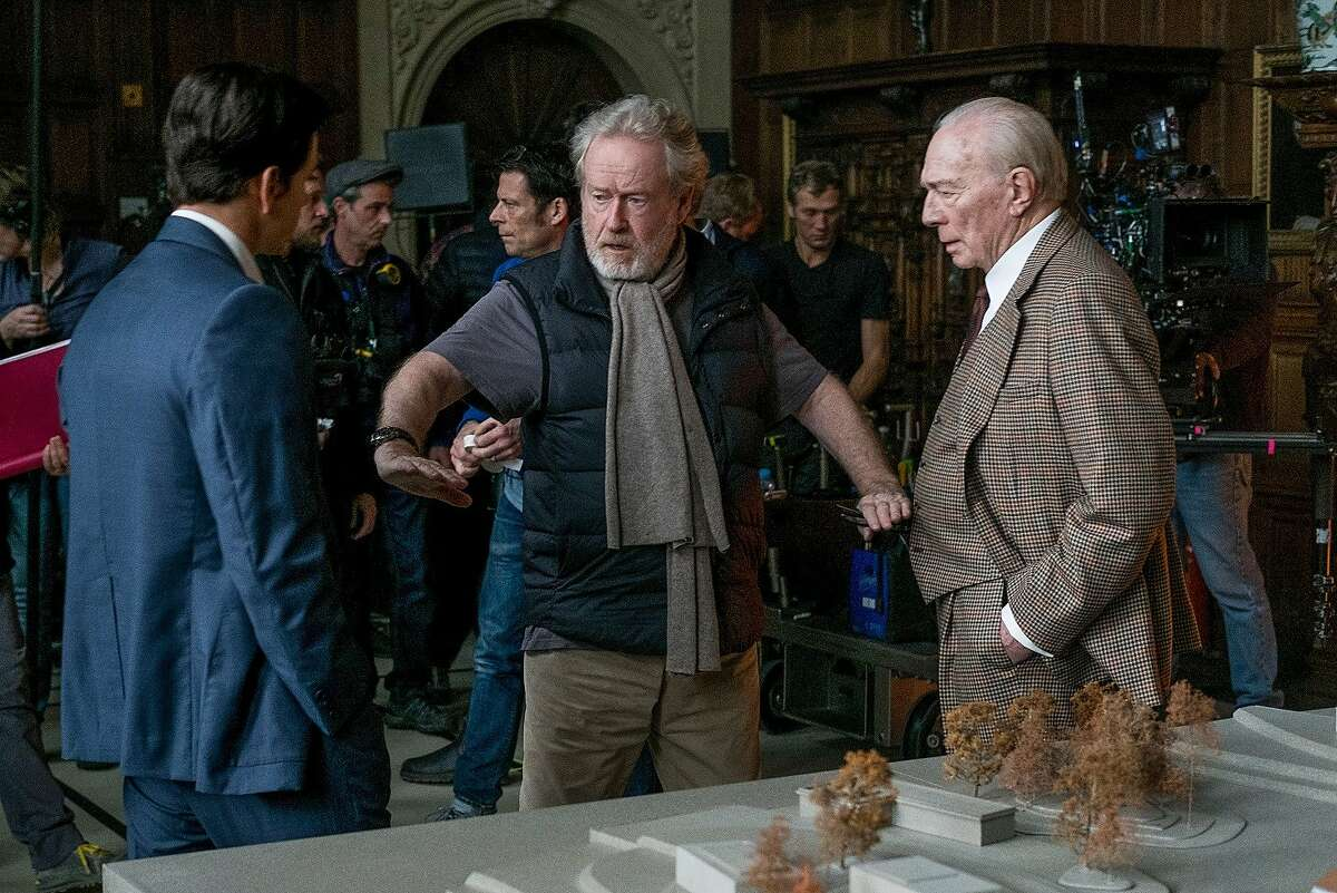 """Mark Wahlberg (left) and Christopher Plummer (right) receive direction from Ridley Scott (center) on the set of """"All the Money in the World."""" Photo: Giles Keyte"""
