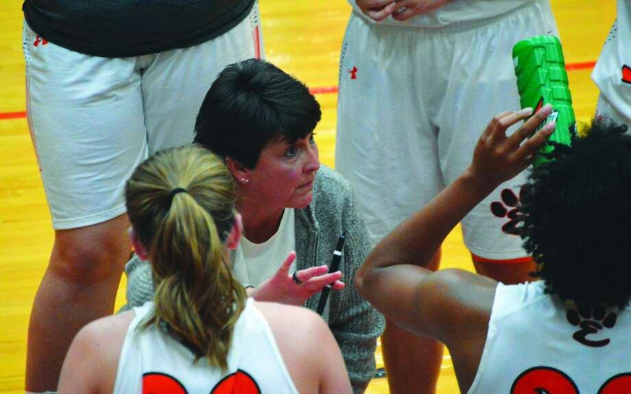 Edwardsville girls' basketball coach Lori Blade talks to her team during a timeout in a regular-season game against Belleville East.