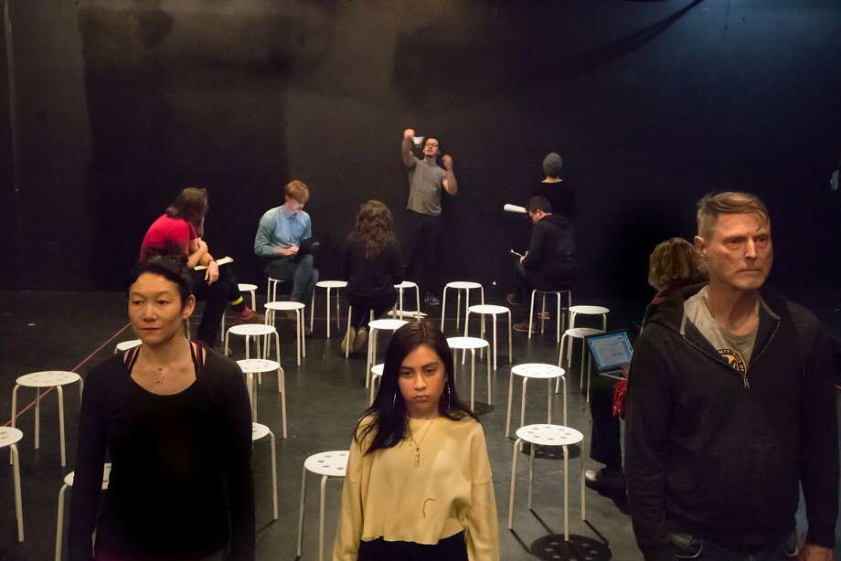 """Erin Mei-Ling Stuart, Nayeli Rodriquez and Don Wood rehearse in Mugwumpin's """"In Event of Moon Disaster."""" on Tuesday, Dec. 19, 2017 in San Francisco, Calif. The audience will sit on the stools for this scene. Photo: Paul Kuroda, Special To The Chronicle"""
