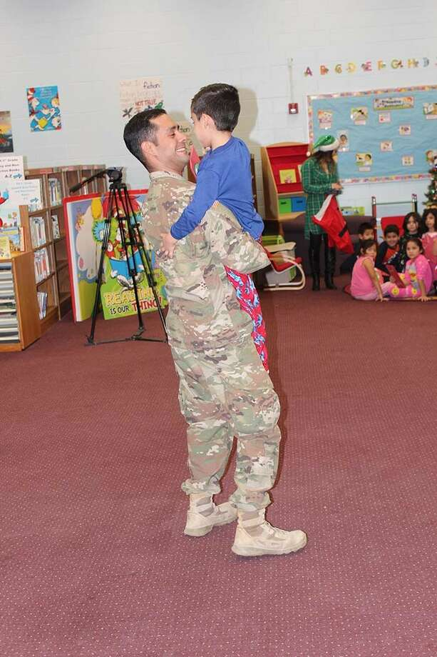 The embrace both father and son waited over a year for. Sgt. Gonzalez and his son, Cristian, reunited.   Photo: UISD/Courtesy