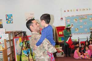 The embrace both father and son waited over a year for. Sgt. Gonzalez and his son, Cristian, reunited.