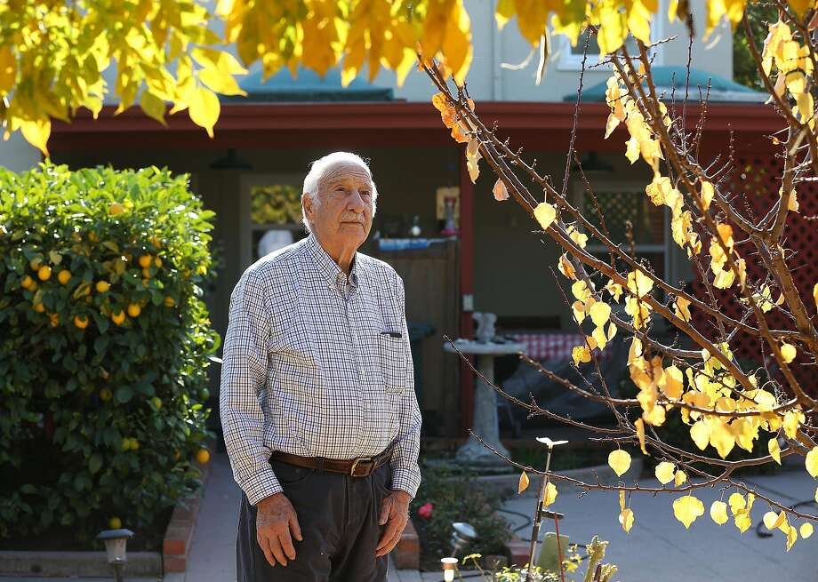 George Dini, 94, who worked for the city for a quarter century, helped create the tree logo and has planted oaks in his San Leandro backyard. Photo: Liz Hafalia, The Chronicle
