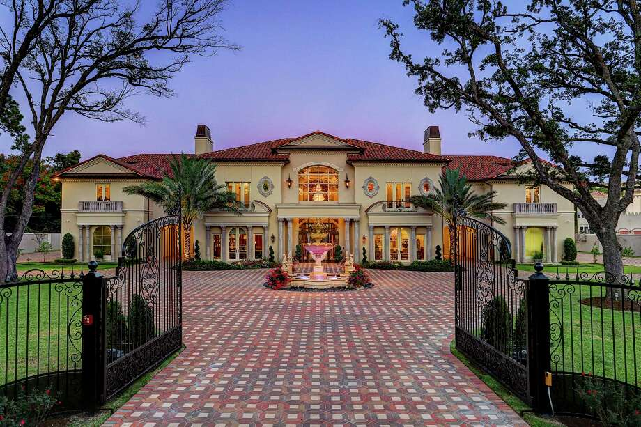 Prime property luxury high end amenities define Mediterranean style homes houston