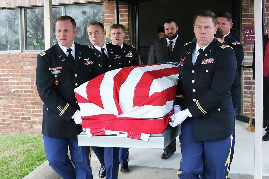 One member of the U. S. Army detail carrying Lowe's casket is in tears and his colleagues stone-faced as they carry their comrade outside of the church on his way to his final resting place at Guedry Cemetery in Batson. Photo: David Taylor
