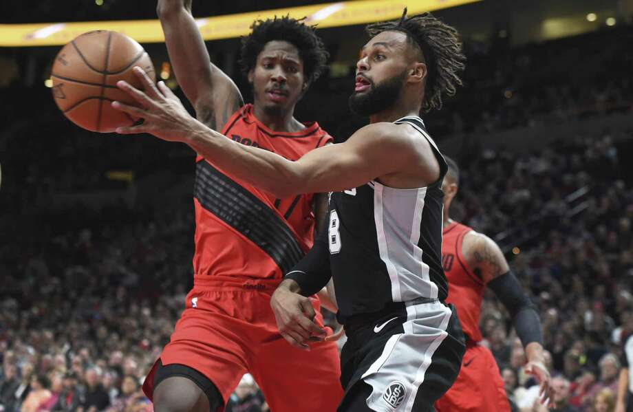 San Antonio Spurs guard Patty Mills drives to the basket on Portland Trail Blazers forward Ed Davis during the first half of an NBA basketball game in Portland, Ore., Wednesday, Dec. 20, 2017. (AP Photo/Steve Dykes) Photo: Steve Dykes, FRE / Associated Press / FR155163 AP