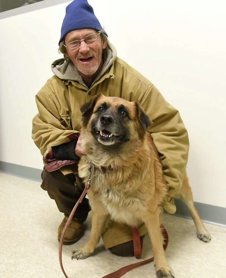 Fredrick Pangburn and his dog Thumper at Mohawk Hudson Humane Society on Friday, Dec. 22, 2017 in Menands, N.Y. Volunteers have offered to drive the homeless man and his beloved dog to West Virginia where his daughter lives because there was no other way to take his pet down there or for him to stay here with the pet. (Lori Van Buren / Times Union) Photo: Lori Van Buren, Albany Times Union / 20042492A